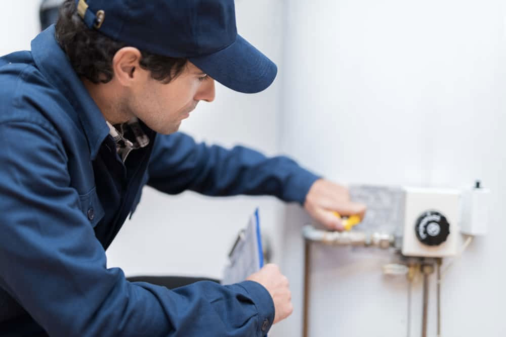 Water heater service person