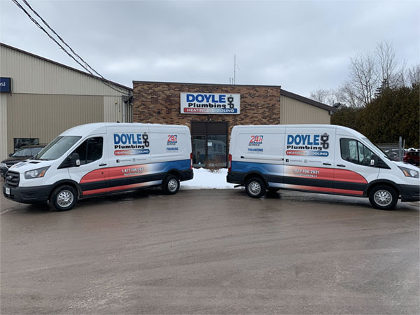 Doyle Plumbing, Heating & Cooling trucks
