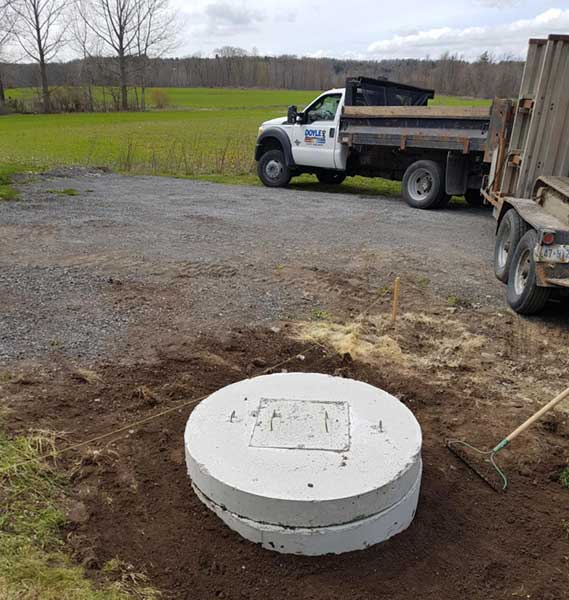 New well lid and tile installation